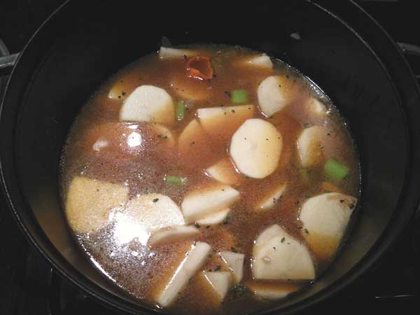 Add in the broth and habanero pepper.