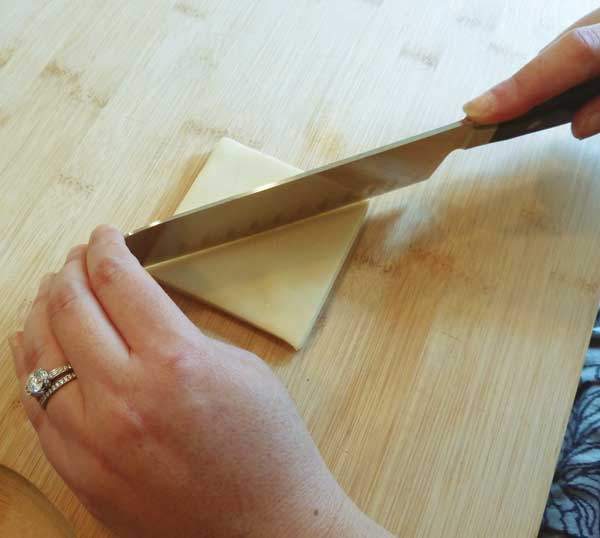 Slice the wonton wrappers into quarters- squares or triangles.