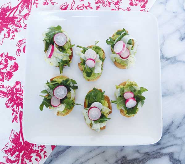 Breakfast Radish Crostini with Avacado, Fennel and Arugula.