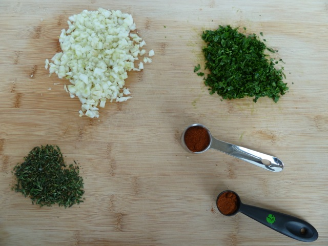 Chopped fennel, parsley, thyme, one tablespoon of paprika and one teaspoon of cayenne pepper.