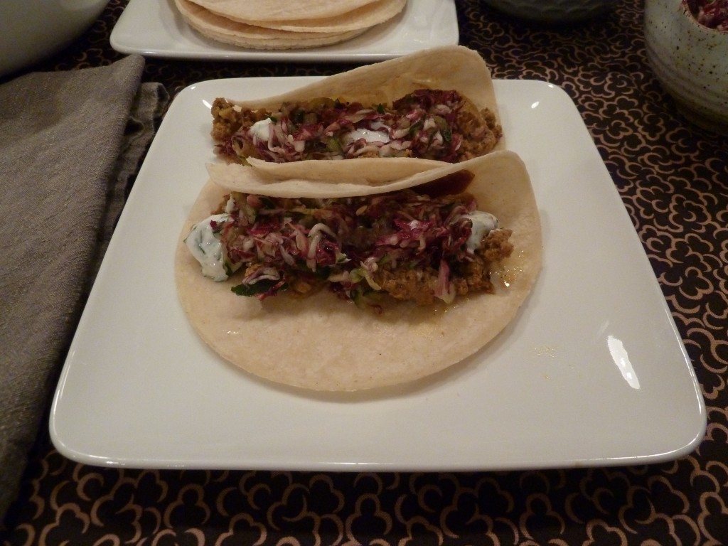 Moroccan tacos with yogurt herb sauce and radicchio cucumber honey slaw.