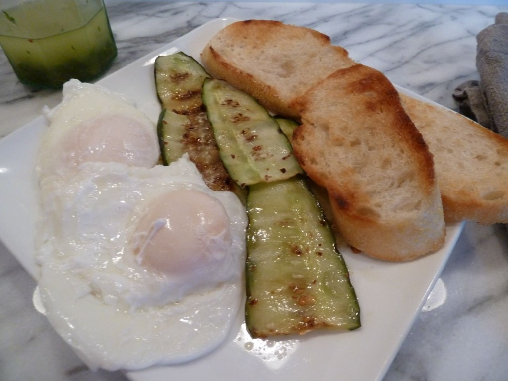 Poached eggs, grilled spicy cucumbers and grilled baguette slices with a side of mint and parsley vinaigrette.