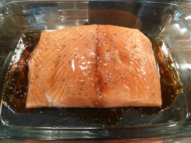 Add maple syrup, sea salt and pepper to the salmon.