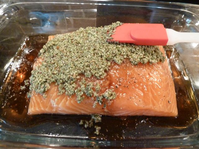 Firmly press the almond mixture onto the salmon.
