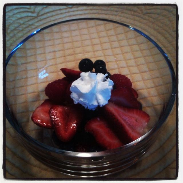 Fresh berries in Amaretto with whipped cream.
