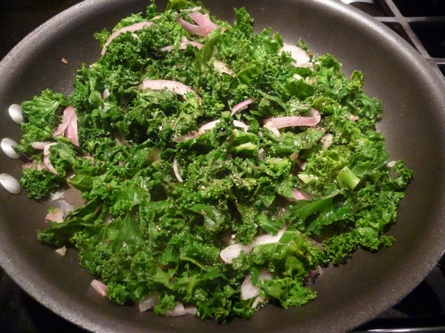 Toss the kale, onion and garlic all together.