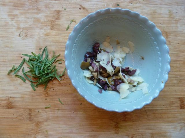 Fresh rosemary, olives and garlic for topping.