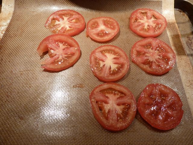 Add sliced tomatoes on a silpat for roasting.