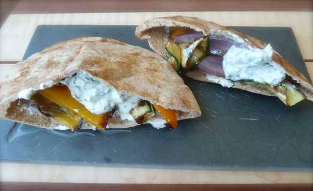 Pita bread stuffed with grilled veggies and yogurt-ricotta spread.