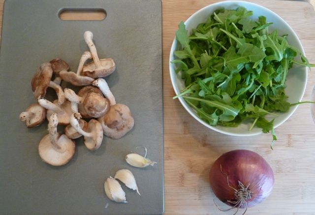 Shitake, fresh arugula, red onion and garlic.