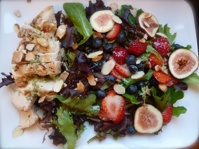 Salad with chicken, fresh figs, strawberries, blueberries and toasted almonds.